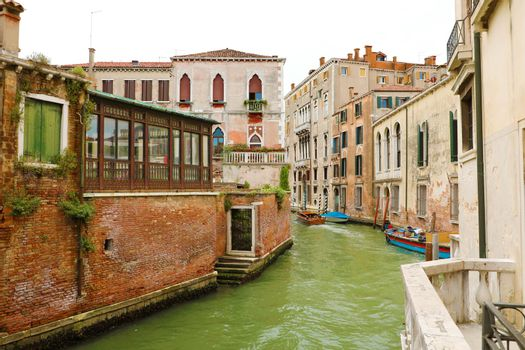 Old palaces and boats on canal in Venice, Italy