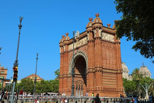 BARCELONA, SPAIN - JULY 11, 2018: The Arc de Triomf is a triumphal arch in the city of Barcelona in Catalonia, Spain. The arch is built in reddish brickwork in the Neo-Mudejar style.