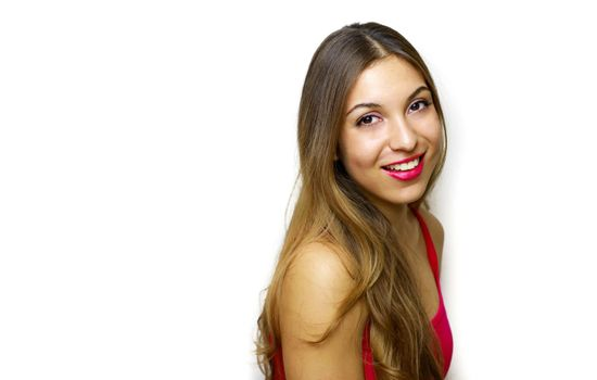 Side view of beautiful smiling woman looking at camera on white background. Copy space.