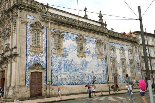 PORTO, PORTUGAL - JUNE 21, 2018: Detail of the facade of the Carmo church (Igreja do Carmo) with Azulejo, Porto, Portugal