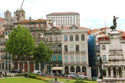 PORTO, PORTUGAL - JUNE 21, 2018: Houses in Porto with the cathedral and Infante Dom Henrique statue, Porto, Portugal