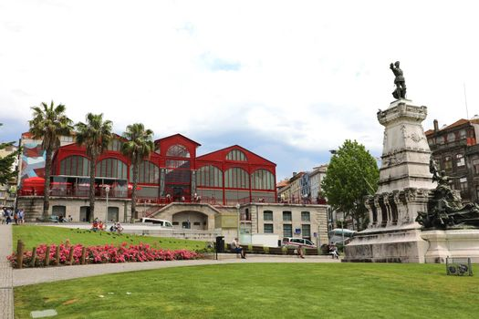 PORTO, PORTUGAL - JUNE 21, 2018: Infante Dom Henrique statue and Ferreira Borges marketplace, Porto, Portugal