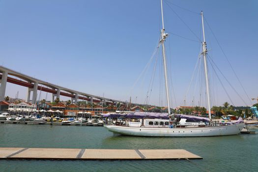 LISBON, PORTUGAL - JUNE 24, 2018: Luxury yachts under the 25 april bridge in Lisbon, Portugal