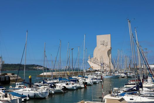 BELEM, PORTUGAL - JUNE 25, 2018: Marina in Belem district of Lisbon and Monument to the Discoveries on background, Lisbon, Portugal