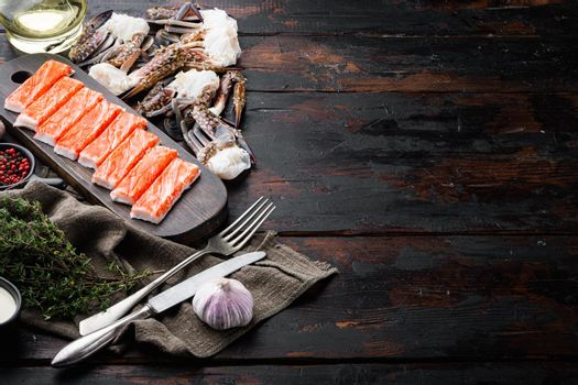 Fresh Crab meat stick surimi , on dark wooden background , with copyspace and space for text