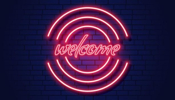 neon welcome signboard on brick wall background