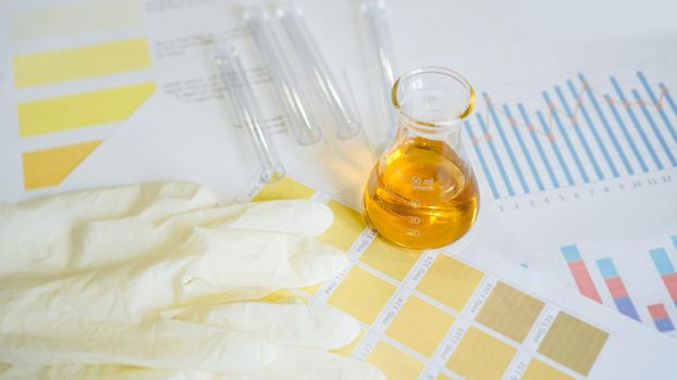 Urine test. Flask with analyzes on medical tables with color determination