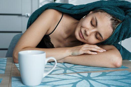 Tired woman sleeping on the table. Lazy sleepy morning