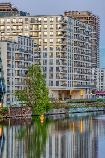 Big modern apartment building at the river Spree