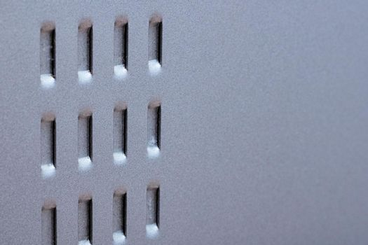 The grille on the metal surface close up
