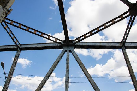 Metal beams on the sky with clouds background close up