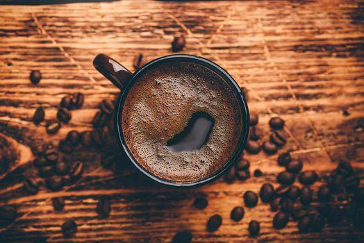 Brewed black coffee in metal mug