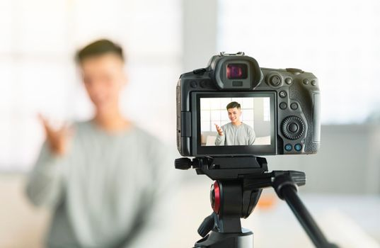Young man recording video for an internet reportage or tutorial streaming