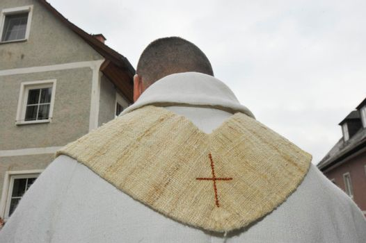 a roman catholic priest, a religious leader in christian religion