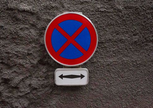 no parking and no stopping traffic sign on the street