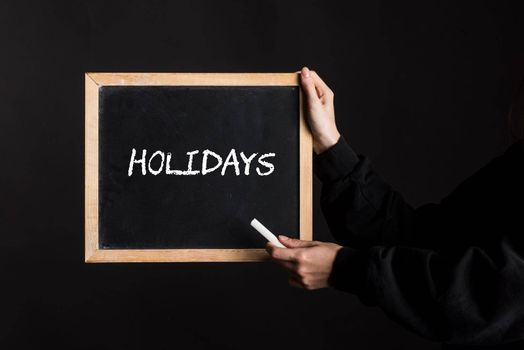 a holidays sign, the symbol for vacation, travel or tourism