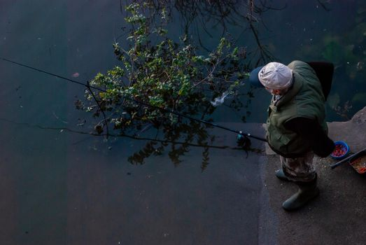 Uncle while fishing on the banks of the Thames at sunset.
