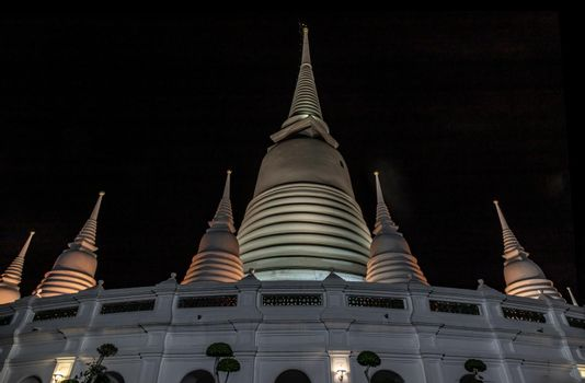 Phra Borommathat Maha Chedi, The main big white pagoda at night that is a landmark of Wat Prayurawongsawas Warawihan.