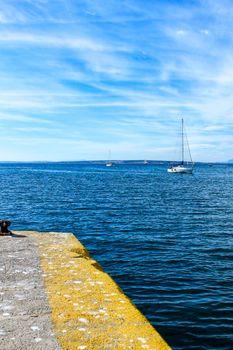 Sailboat entering the port of Santa Pola