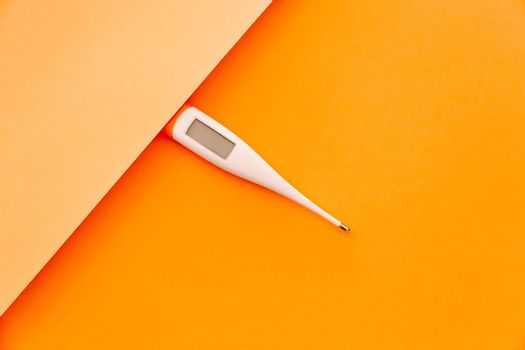 Thermometer over a minimal orange background