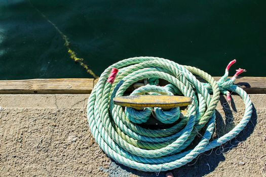 Blue coiled rope in the dock