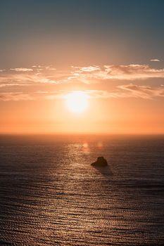 A massive sunset over the horizon on the coast