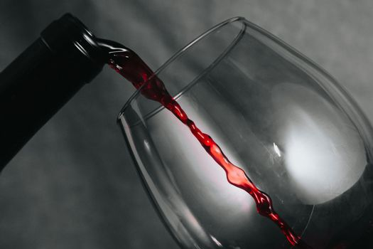 A bottle of wine serving wine in a cup with copy space in time stop with copy space
