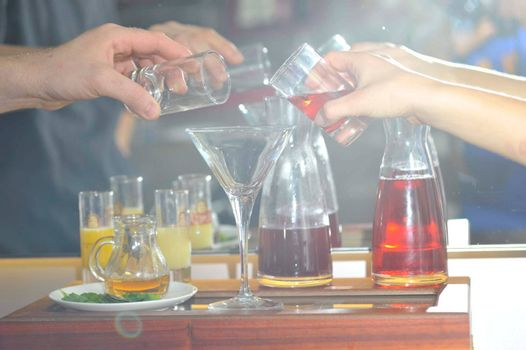 enjoying of alcoholic drinks and beverages in a cocktail bar