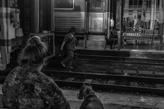 Bangkok, thailand - jun 29, 2019 : The woman and her dog are waiting Train At Hua Lamphong Railway Station or Hua Lamphong Station is the main railway station in Bangkok, Blackand white.