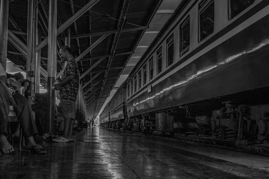Bangkok, thailand - jun 29, 2019 : Peoples who sit and wait to return to their homeland. Bangkok Railway Station or Hua Lamphong Station is the main railway station in Bangkok, Thailand, Black and white.