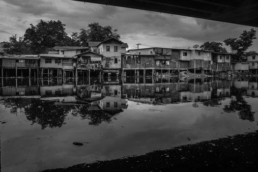 bangkok,Thailand - jun 30, 2019 : Traditional old house on Khlong Phra Khanong and near the expressway, Black and white.