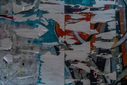bangkok,Thailand - jun 29, 2019 : Colorful torn posters on grunge old walls as creative and abstract background, Background Or Texture With Copy Space, Toned Image.