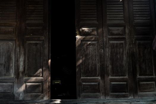 Traditional Thai style wooden door, The traditional house, Light and Shadow.
