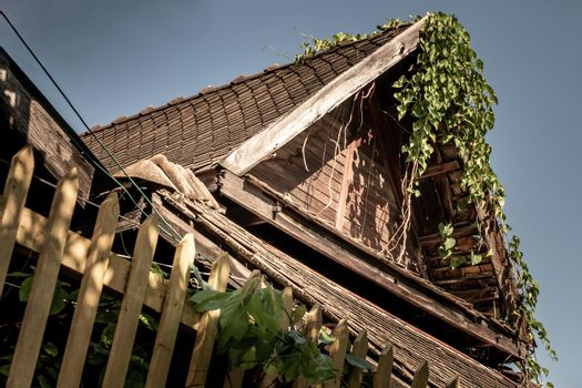 Thai style wooden gable roof, The traditional house, Old abandoned house, Light and Shadow.