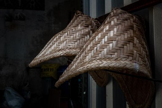 Close-up of Two bamboo basket steamer for steamed glutinous rice or sticky rice hanging on a stainless steel fence. Equipment for cooking
