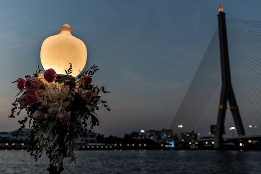 Beautiful lamp Riverside Chao Phraya River with the Rama VIII Bridge, Bangkok.