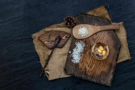 Sticky Rice Cooked with Coconut milk (Khao lam) or Glutinous rice roasted in bamboo joints on wooden, Thai dessert concept, Top view.