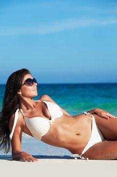 Woman in bikini on sea beach