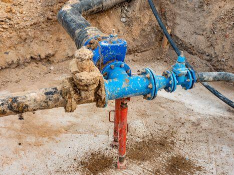 Repair of the main potable water supply branch in the suburbs. Repairing process