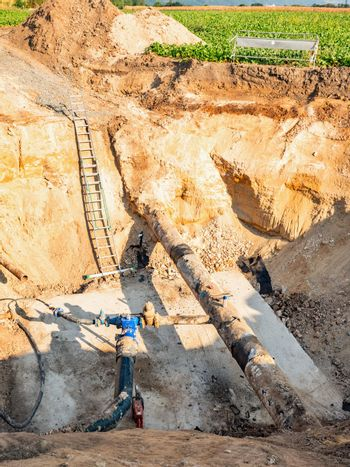 Deep trench in ground to for a large water supply pipeline.