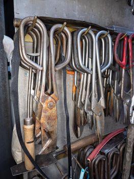 Rack of shaped Glassblowing Diamond Shear Scissors.