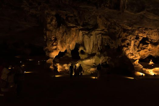 Silhouettes of people against rock formations in the Cango Caves