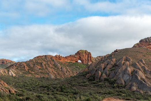 Vensterkop, a hole in the mountain at Red Stone Hills