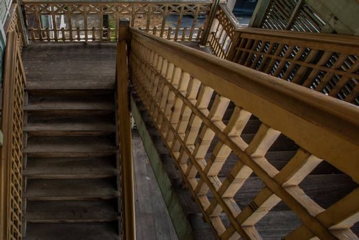 Nonthaburi, Thailand - JUL 21,2019 : The stairs to the 2nd floor of old city hall, European style building. The vintage white wooden house was left to deteriorate over time, Once be Former city hall. Established on 1548, is tranformed to be the museum of Nonthaburi in 2009.