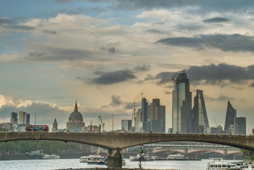 London, United Kingdom - APR 17, 2019 : The skyscrapers of London along the River Thames give the city a modern style.
