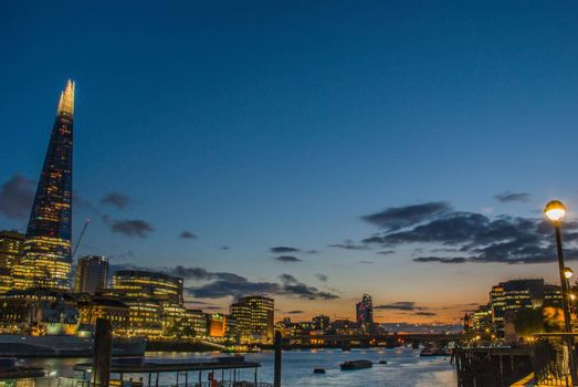 Sunset on the London skyline with the new The Shard skyscraper. Long exposure.