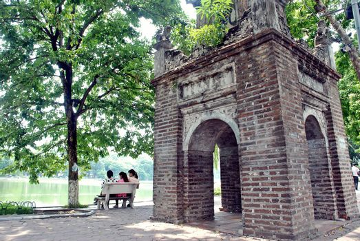 3 girls sitting on a rocky horse at Rim Bueng. Hanoi