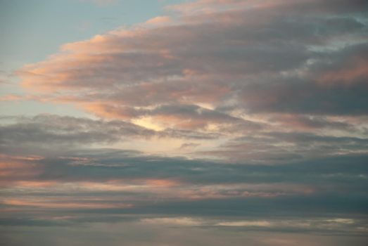 Beautiful sky with cloud before sunset. The softness of the clouds and the brightness of the sky. Light blue background. Relaxing feeling and inspirational.