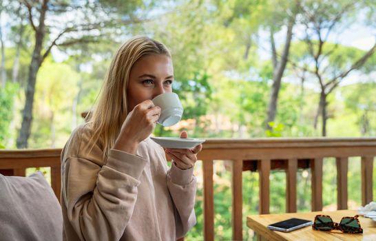 Woman Drinking Coffee on Terrace