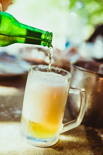 Foamy Beer. Glass of Light Beer. Pouring into the Mug. Glass Full of Foam. Cold Beer on the Table. Evening in the Pub. Beer is Always Good Idea.